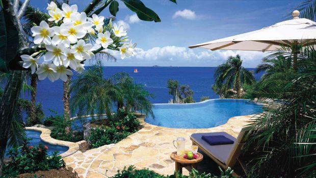 Un decor magnific pentru un cuplu proaspat casatorit: Rosewood Little Dix Bay, din Virginele Britanice Cele mai bune insule din Caraibe pentru petrecerea lunii de miere Rosewood Little Dix Bay