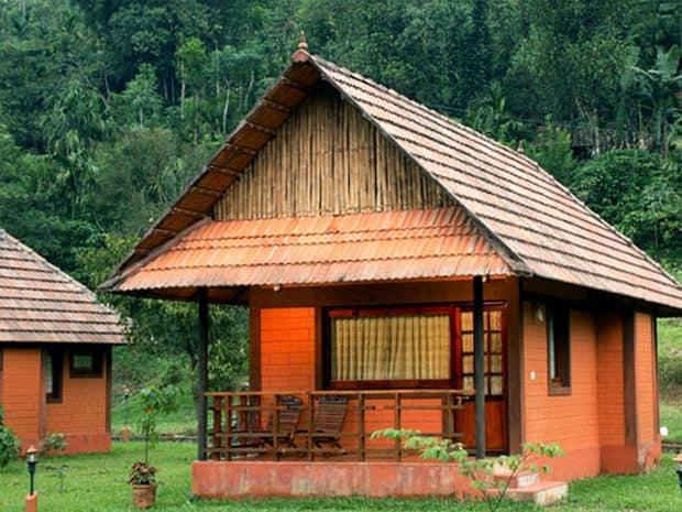Wayanad's Stream Valley Cottages